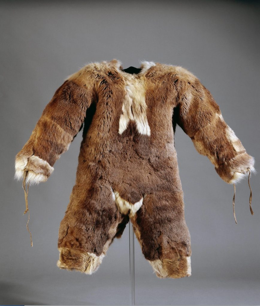 Child's all-in-one suit made of caribou fur. Inuit, Igloolik, Nunavut, Canada. 1980s. © Trustees of the British Museum.